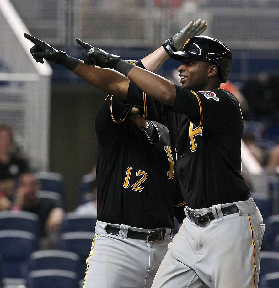 The Pittsburgh Pirates' Gregory Polanco, right, is congratulated by teammate Clint Barmes after hitting a two-run home run in the 13th inning against the Miami Marlins on Friday, June 13, 2014, at Marlins Park in Miami. The Pirates won, 8-6, in 13 innings. (David Santiago/El Nuevo Herald/MCT) Photo: David Santiago, McClatchy-Tribune News Service