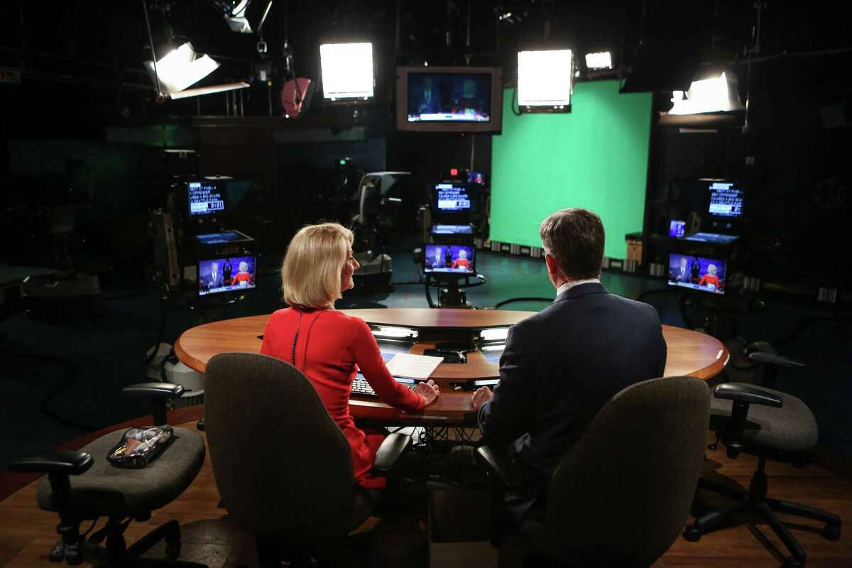KING/5 News anchor Jean Enersen and anchor Dennis Bounds prepare to go on the air during Enersen's final night as regular anchor of the KING/5 evening news.