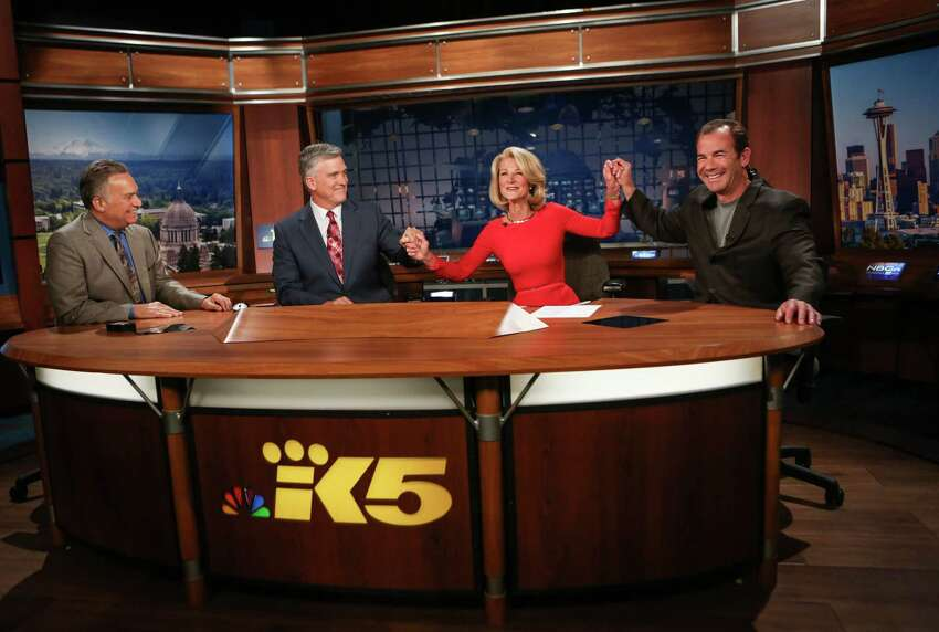 From left, KING/5 News meteorologist Jeff Renner, anchor Dennis Bounds, anchor Jean Enersen and sports anchor Paul Silvi say goodbye to Enersen on her final night as regular anchor of the KING/5 evening news. Enersen, who has worked at the station for 46 years, was the anchor for 42 years. Enersen was the first female anchor in the country. Photographed on Friday, June 13, 2014.