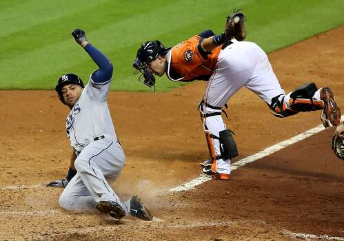 June 13: Rays 6, Astros 1  While former Elkins standout James Loney, left, enjoyed his homecoming, Houston didn't in a series-opening loss to Tampa Bay.  Record: 31-38. Photo: James Nielsen, Houston Chronicle