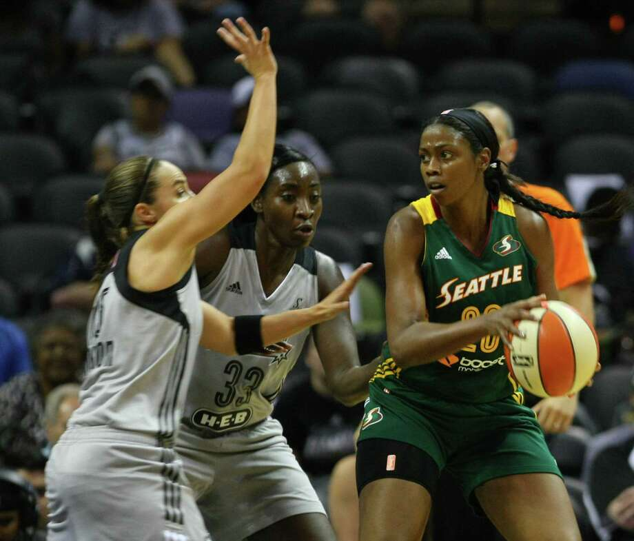 The Stars' Becky Hammon (left) and Sophia Young-Malcolm try to guard Seattle's Camille Little, who keyed a balanced Storm attack with 13 points Friday. Danielle Adams led the Stars with 18 points. Photo: Timothy Tai / San Antonio Express-News / © 2014 San Antonio Express-News