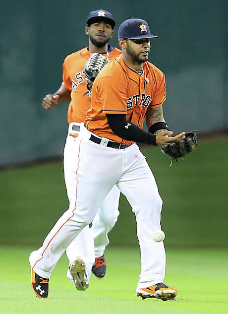 Shortstop Jonathan Villar drops James Loney's popup to lead off the second, and it only got worse from there for the Astros, who lost 6-1 Friday night. Photo: James Nielsen, Staff / © 2014  Houston Chronicle