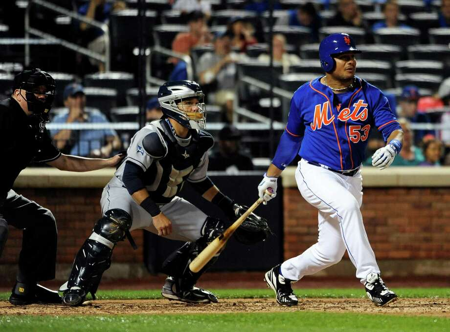 New York Mets' Bobby Abreu (53) hits an RBI single off of San Diego Padres starting pitcher Andrew Cashner as Rene Rivera catches for the Padres in the fifth inning of a baseball game at Citi Field on Friday, June 13, 2014, in New York. (AP Photo/Kathy Kmonicek) ORG XMIT: NYM122 Photo: Kathy Kmonicek / FR170189 AP
