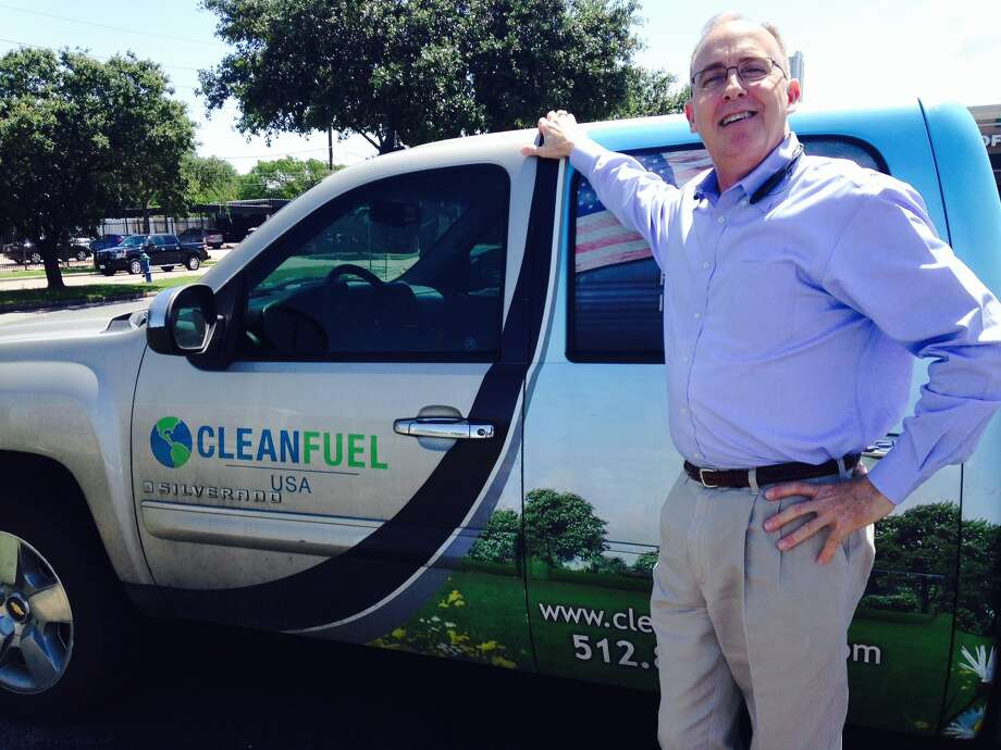 Curtis Donaldson, managing director of CleanFUEL USA, shown with a company vehicle in a Houston parking lot in 2014, founded the company in 1993 to make propane-fueled vehicles and pumps to fuel them. Photo: Ryan Holeywell / ONLINE_YES