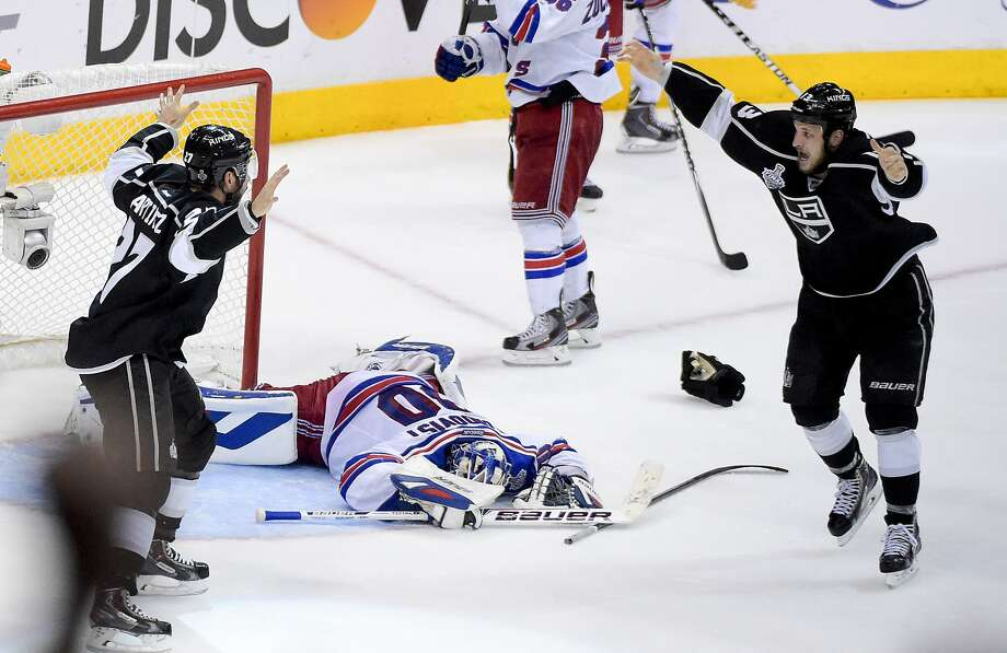 Alec Martinez (left) celebrates with Kyle Clifford after Martinez's goal gave the Kings a second Stanley Cup in three seasons. Photo: Mark J. Terrill, Associated Press