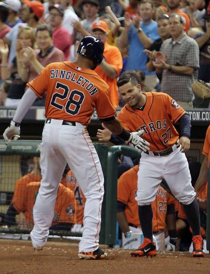 Astros first baseman Jon Singleton, left, celebrates with Jose Altuve a home run. Photo: James Nielsen, Houston Chronicle