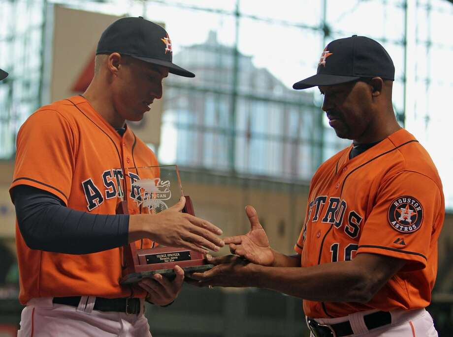 Astros right fielder George Springer, left, receives his American League Rookie of the Month trophy from manager Bo Porter, right, before the series opener against the Rays. Photo: James Nielsen, Houston Chronicle