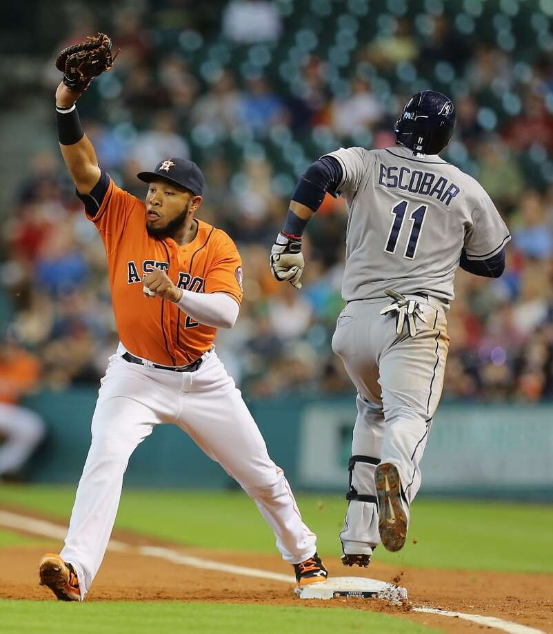 June 13: Rays 6, Astros 1Astros first baseman Jon Singleton, left, tags out Yunel Escobar during the second inning. Photo: James Nielsen, Houston Chronicle