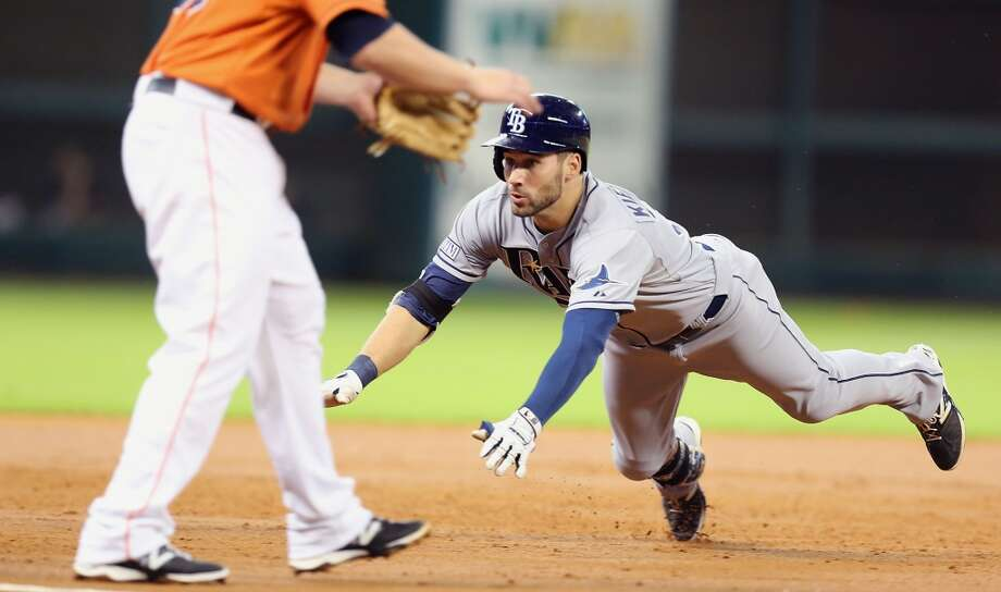 Rays right fielder Kevin Kiermaier slides into third base during the third inning. Photo: James Nielsen, Houston Chronicle