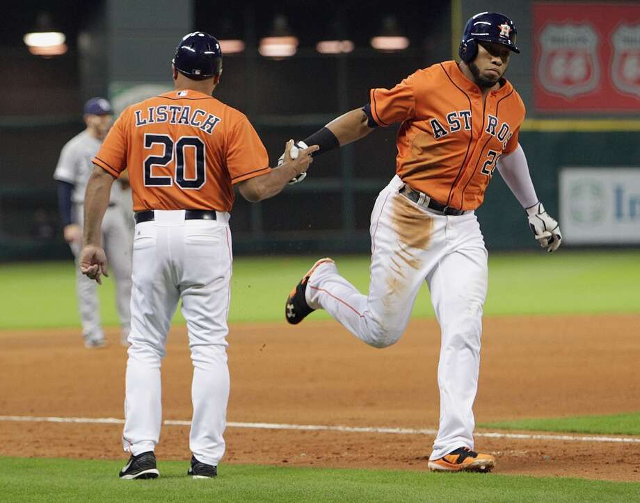 Astros first baseman Jon Singleton, right, shakes hands with third base coach Pat Listach after his home run. Photo: James Nielsen, Houston Chronicle