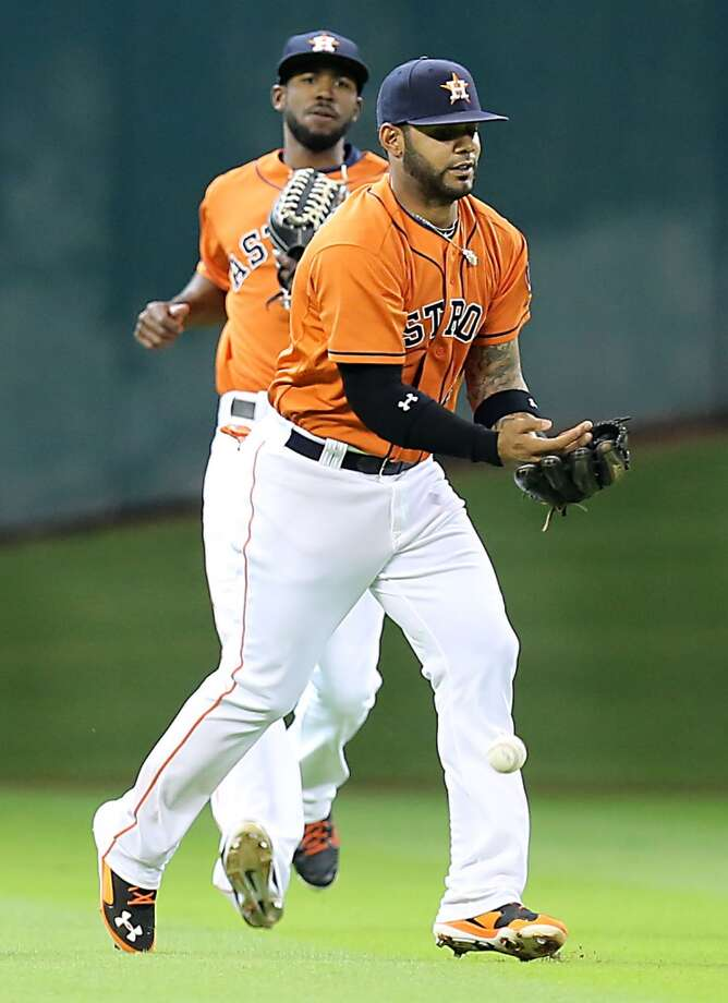 Astros shortstop Jonathan Villar, right, drops the ball during the second inning. Photo: James Nielsen, Houston Chronicle