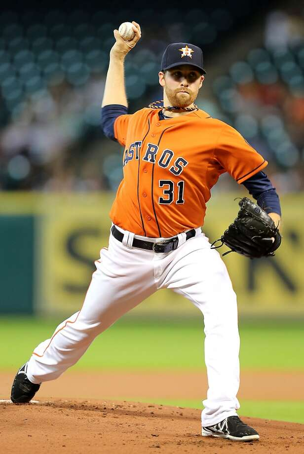 Astros starting pitcher Collin McHugh throws a pitch against during the first inning. Photo: James Nielsen, Houston Chronicle
