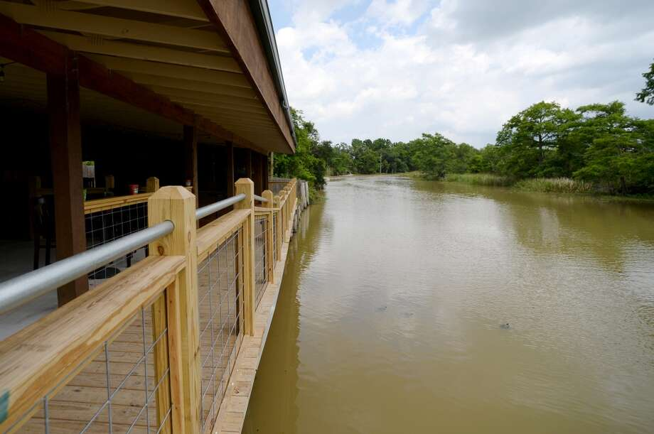 A trio of turtles floats near the edge of the Pine Tree Lodge's new dance floor Friday afternoon. Pine Tree Lodge on Taylor Bayou is the Cat5 Bar of the Week for June 5, 2014. Photo taken Friday 5/30/14 Jake Daniels/@JakeD_in_SETX