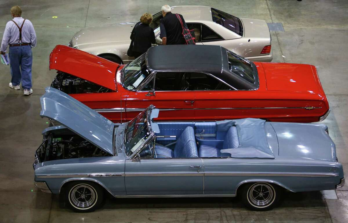 Some of the hundreds of cars are shown during the Mecum rare and collector car auction at CenturyLink Field Events Center on Friday, June 13, 2014. The auction brought hundreds of classic and rare cars to bidders. The bidding action was recorded and to be aired on NBC Sports Network. The event continues on Saturday.
