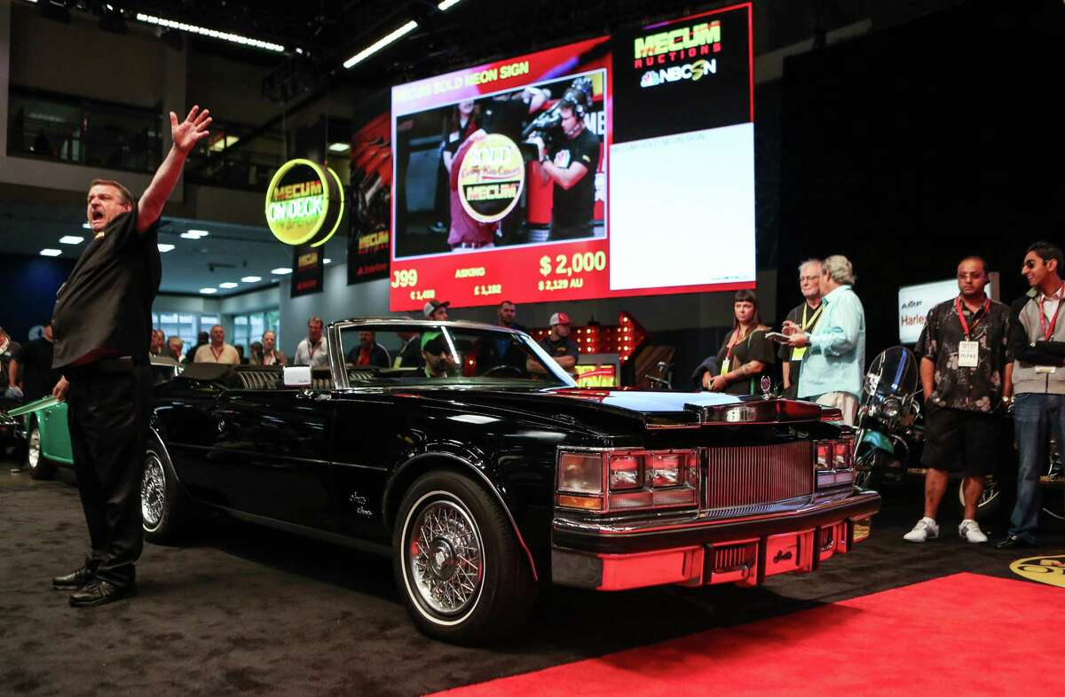A Cadillac Seville is shown as a bid is made during the Mecum rare and collector car auction at CenturyLink Field Events Center.