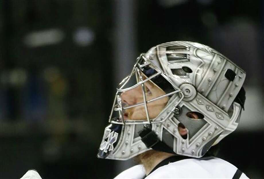 Los Angeles Kings goalie JonathanQuick (32) reacts after giving up a goal to the New York Rangers in the  second period during Game 4 of the NHL hockey Stanley Cup Final,  Wednesday, June 11, 2014, in New York. (AP Photo/Kathy Willens)