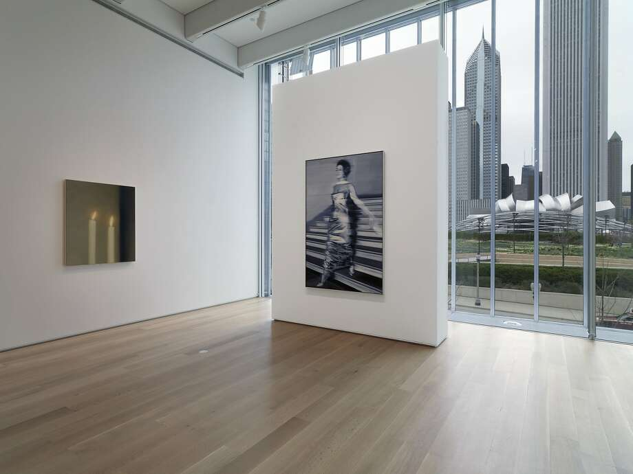 Gallery filled with works by German artist Gerhard Richter in Renzo Piano's Modern Wing of the Art Institute of Chicago. The Chicago skyline and Millennium Park seen through the windows. Photo: Dave Jordano, Art Institute Of Chicago