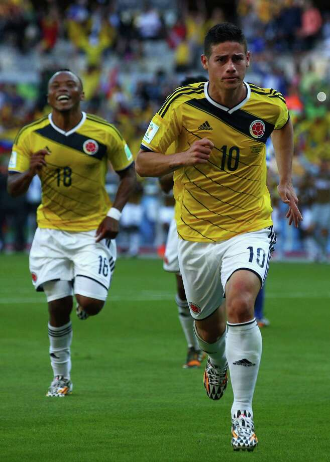 BELO HORIZONTE, BRAZIL - JUNE 14: James Rodriguez of Colombia (front) and Juan Camilo Zuniga celebrate the third goal  during the 2014 FIFA World Cup Brazil Group C match between Colombia and Greece at Estadio Mineirao on June 14, 2014 in Belo Horizonte, Brazil. Photo: Ian Walton, Getty Images / 2014 Getty Images