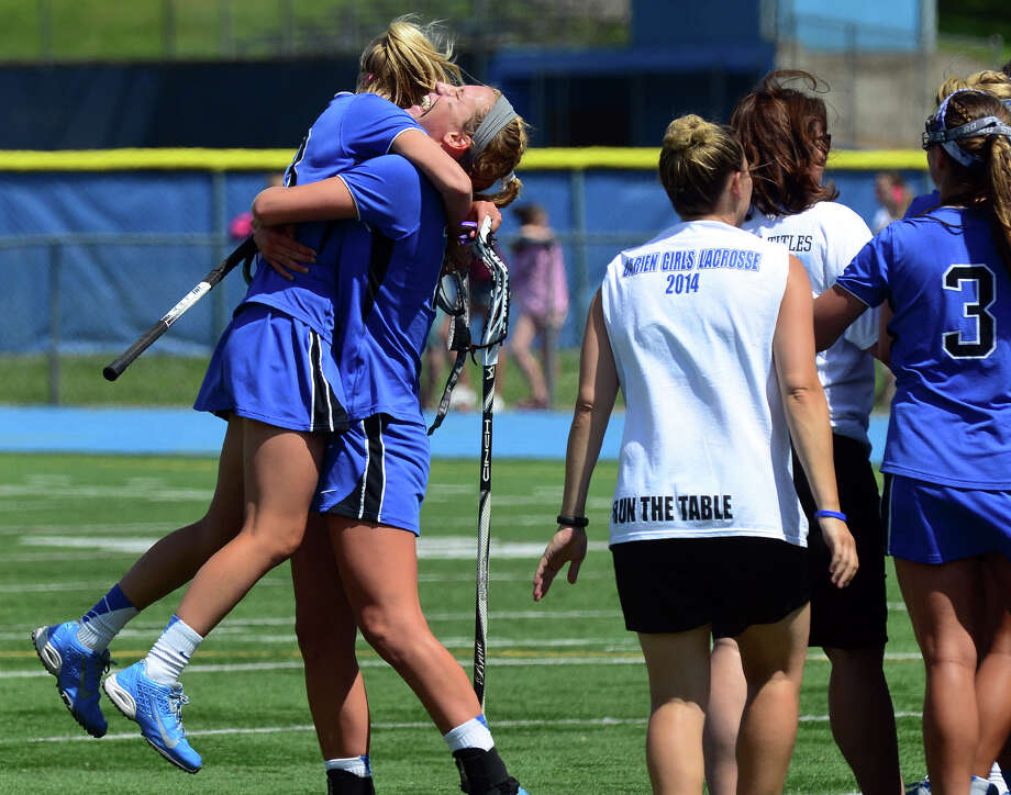 Darien's Eleanor Bennett hugs teammate Kelly Karczewski after they beat Glastonbury, during CIAC Class L lacrosse action in Stratford, Conn. on Saturday June 14, 2014. Photo: Christian Abraham / Connecticut Post