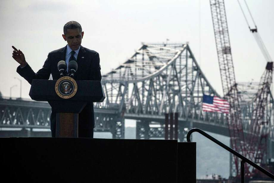 TARRYTOWN, NY - MAY 14:  U.S. President Barack Obama delivers remarks on infrastructure in the United States at the Washington Irving Boat Club on May 14, 2014 in Tarrytown, New York. Tomorrow President Obama will attend the opening of the National September 11 Memorial and Museum.  (Photo by Andrew Burton/Getty Images) ORG XMIT: 490663669 Photo: Andrew Burton / 2014 Getty Images