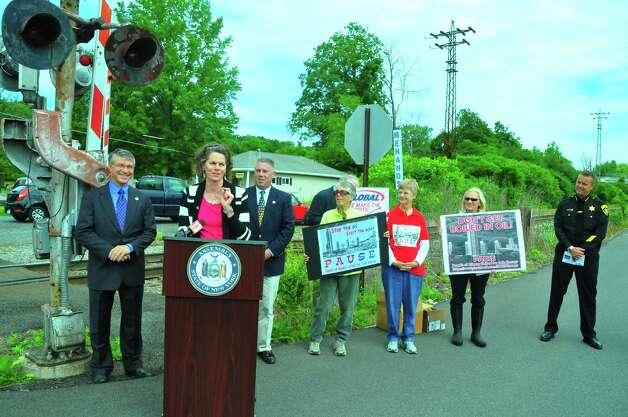 From left, state Assembly members Phil Steck (D-Colonie), Patricia Fahy (D-Albany) and John T. McDonald III (D-Cohoes) and, far right, Albany County Sheriff Craig Apple discuss legislation related to oil trains on Saturday, June 14, 2014, in Menands. (Steve Barnes/Times Union)