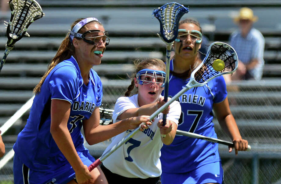 Glastonbury's Lindsay Shettle looks to block Darien's Dillon Schoen as she drives towards the goal, during CIAC Class L lacrosse action in Stratford, Conn. on Saturday June 14, 2014. Photo: Christian Abraham / Connecticut Post