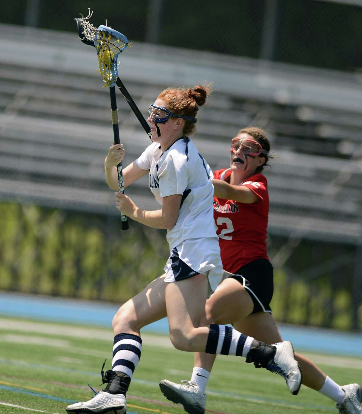 Wilton's Shannon Quinlan controls the ball as New Canaan's Elizabeth Burke defends Saturday, June 14, 2014, during the Class M Girls Lacrosse final at Bunnell High School in Stratford, Conn.