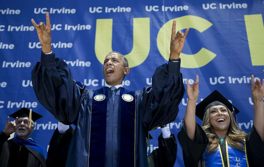 President Obama flashes the symbol of the UC Irvine Anteaters after speaking to the school's graduates. Photo: Manuel Balce Ceneta, Associated Press