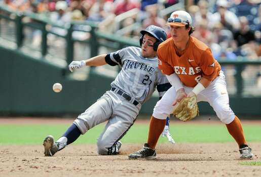UC Irvine's Grant Palmer (27) reaches second base on a double against Texas second baseman Brooks Marlow (8), in the second inning of an NCAA baseball College World Series game in Omaha, Neb., Saturday, June 14, 2014. (AP Photo/Dave Weaver) Photo: Dave Weaver, Associated Press / FR67562 AP