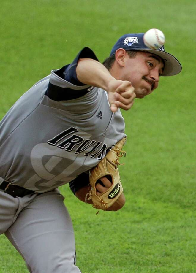 UC Irvine pitcher Andrew Morales (13) delivers against Texas in the first inning of an NCAA baseball College World Series game in Omaha, Neb., Saturday, June 14, 2014. (AP Photo/Nati Harnik) Photo: Nati Harnik, Associated Press / AP
