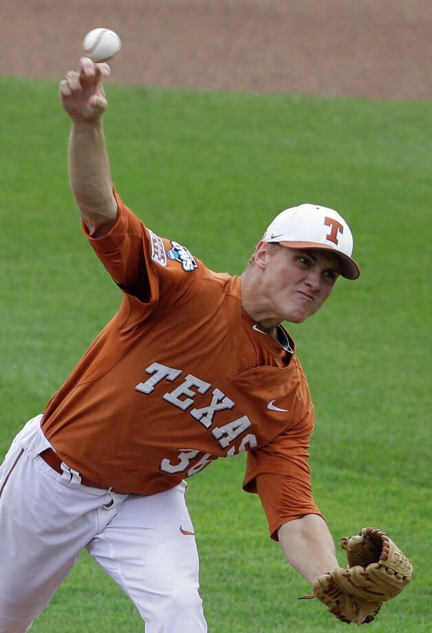 RETRANSMISSION TO CORRECT TEAM - Texas pitcher Nathan Thornhill (36) delivers against UC Irvine in the first inning of an NCAA baseball College World Series game in Omaha, Neb., Saturday, June 14, 2014. (AP Photo/Nati Harnik) Photo: Nati Harnik, Associated Press / AP