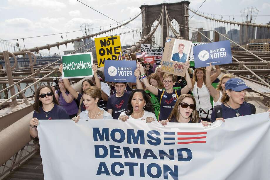 More than 1,000 demonstrators gather to cross the Brooklyn Bridge during a demonstration demanding better laws and enforcement to prevent mass shootings in the United States. Photo: John Minchillo, Associated Press