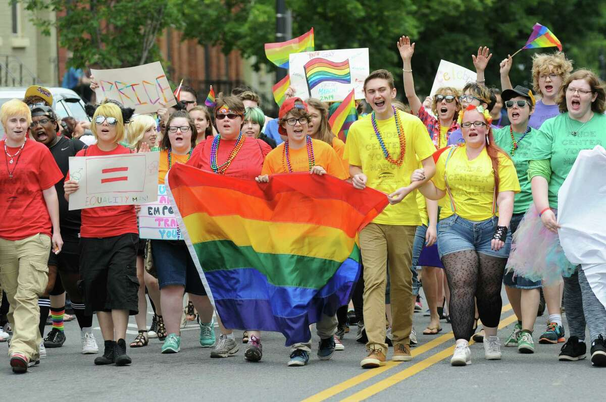 Members of Pride Center Youth march down Lark Street during the Capital Pride Parade on Saturday, June 14, 2014, in Albany, N.Y. (Cindy Schultz / Times Union)