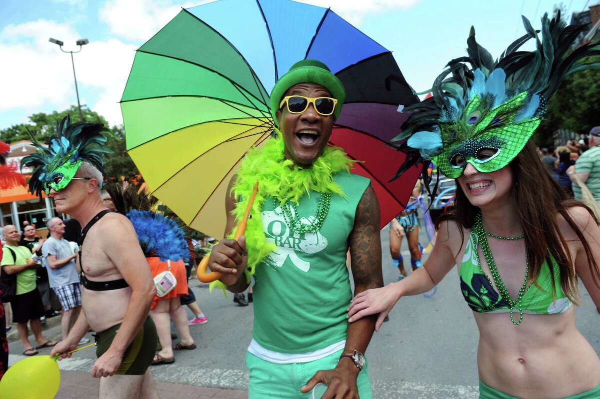 Sean Chappin, center, and Cassie Franklin, right, strut down Lark Street during the Capital Pride Parade on Saturday, June 14, 2014, in Albany, N.Y. (Cindy Schultz / Times Union)