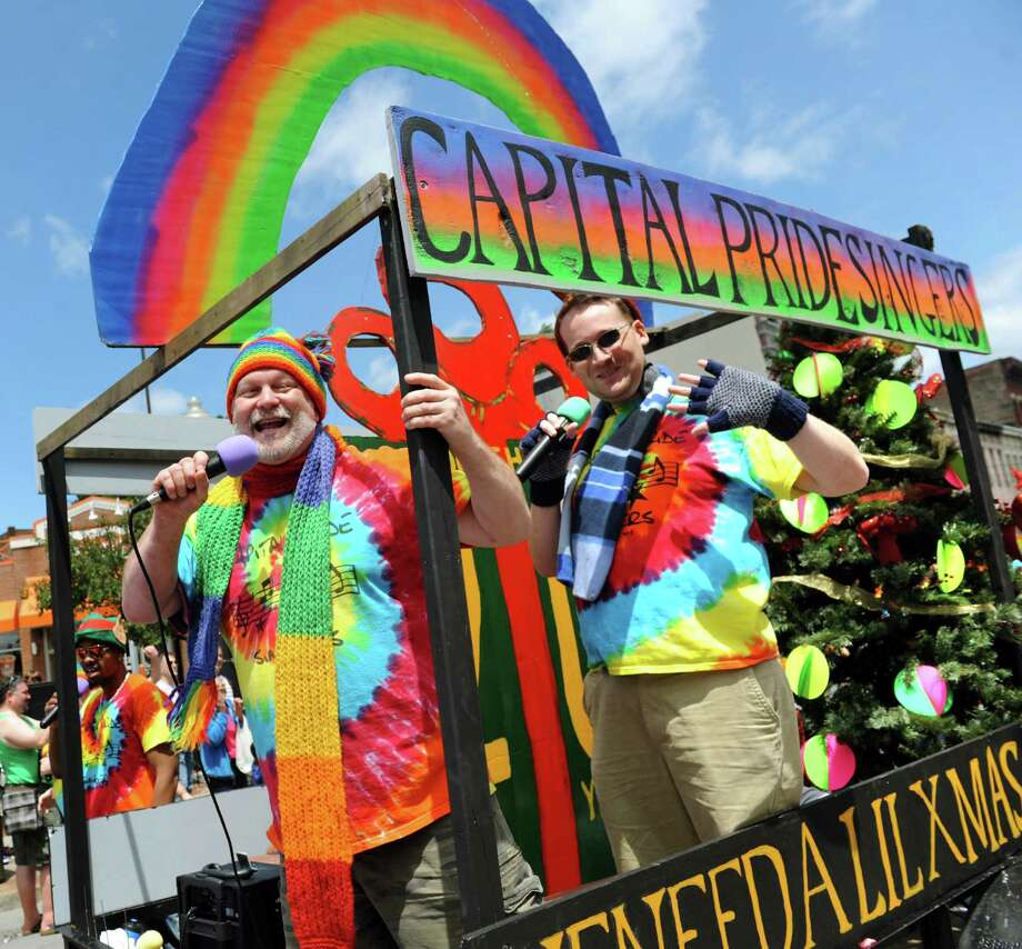 Capital Pride Singers sing a Christmas tune from their float during the Capital Pride Parade on Saturday, June 14, 2014, in Albany, N.Y. (Cindy Schultz / Times Union) Photo: Cindy Schultz / 00027244A