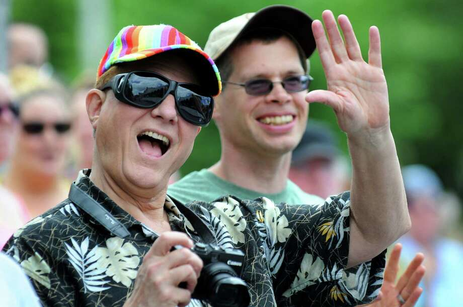 Thomas Levanduski of Guilderland, left, and his husband Jim Reed wave at friends during the Capital Pride Parade on Saturday, June 14, 2014, in Albany, N.Y. (Cindy Schultz / Times Union) Photo: Cindy Schultz / 00027244A