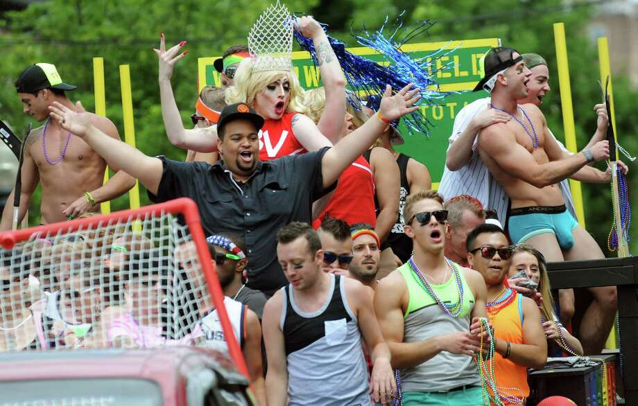 Parade participants party on their float during the Capital Pride Parade on Saturday, June 14, 2014, in Albany, N.Y. (Cindy Schultz / Times Union) Photo: Cindy Schultz / 00027244A