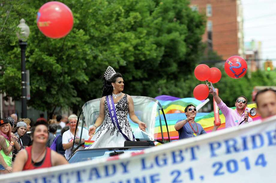 Anastasia, also known as Jason Loveless, center, represents the Duchess of Schenectady during the Capital Pride Parade on Saturday, June 14, 2014, in Albany, N.Y. (Cindy Schultz / Times Union) Photo: Cindy Schultz / 00027244A