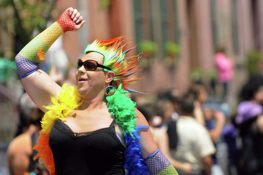Christina, also known as Vinny Smith, prances down Lark Street during the Capital Pride Parade on Saturday, June 14, 2014, in Albany, N.Y. (Cindy Schultz / Times Union) Photo: Cindy Schultz / 00027244A