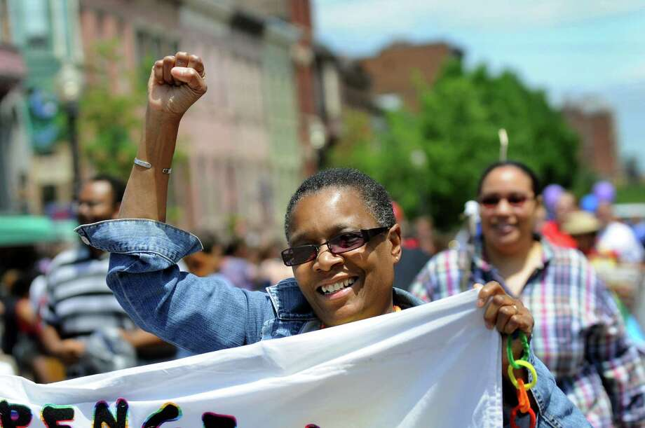 Earlene Bundley, center, marches in the Capital Pride Parade on Saturday, June 14, 2014, in Albany, N.Y. (Cindy Schultz / Times Union) Photo: Cindy Schultz / 00027244A