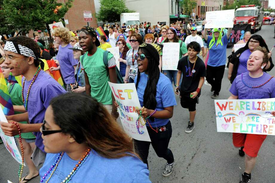 Pride Center Youth members march down Lark Street during the Capital Pride Parade on Saturday, June 14, 2014, in Albany, N.Y. (Cindy Schultz / Times Union) Photo: Cindy Schultz / 00027244A