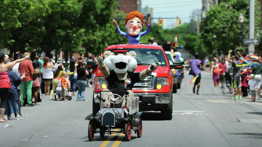ValleyCats mascot South Paw, in front, joins the character representing Mayor Kathy Sheehan in the Capital Pride Parade on Saturday, June 14, 2014, in Albany, N.Y. (Cindy Schultz / Times Union) Photo: Cindy Schultz / 00027244A