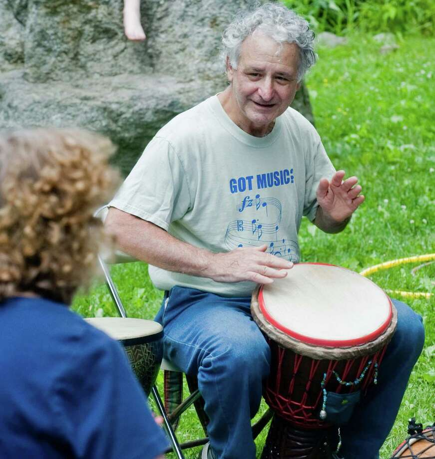 Paul Cook of Bethel plays along with the group in the Drum Circle at the Sticks and Stones Farm annual open house in Newtown. Saturday, June 14, 2014 Photo: Scott Mullin / The News-Times Freelance
