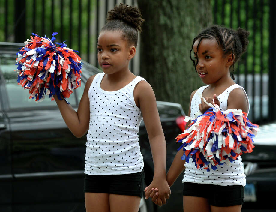 James J. Curiale School students Tamera Powell, 9, and sister Brianna, 8, take part in the Annual Juneteenth African-American Caribbean Freedom Day Parade held in downtown Bridgeport, Conn. on Saturday June 14, 2014. Photo: Christian Abraham / Connecticut Post