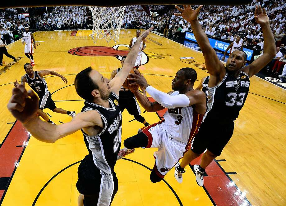 Manu Ginobli and the rest of the Spurs mostly shut down the Heat's Dwyane Wade in Game 4. Photo: Pool, Getty Images