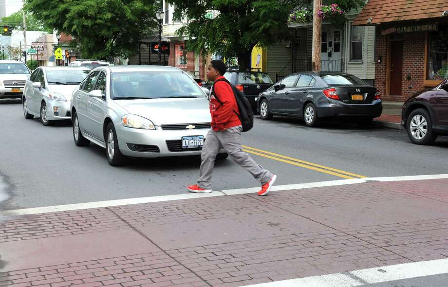 A person uses the crosswalk to cross Delaware Avenue at the intersection of Bertha Street on Friday afternoon, June 13, 2014, in Albany, N.Y.  (Michael P. Farrell/Times Union) Photo: Michael P. Farrell / 00027357A