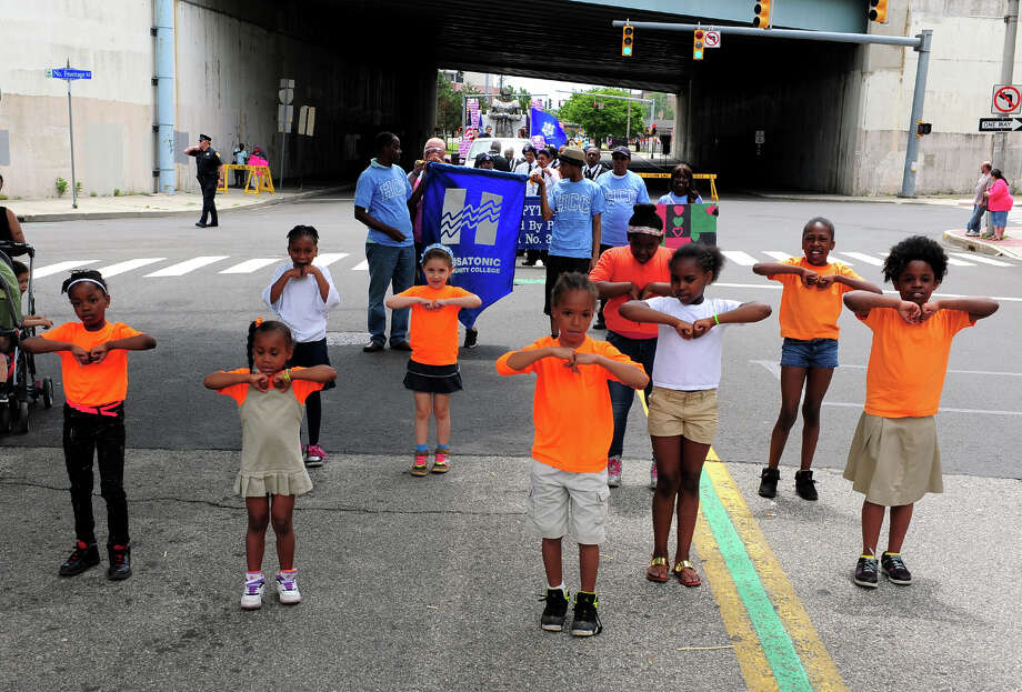 The James J. Curiale School Step Team take part in the Annual Juneteenth African-American Caribbean Freedom Day Parade held in downtown Bridgeport, Conn. on Saturday June 14, 2014. Photo: Christian Abraham / Connecticut Post