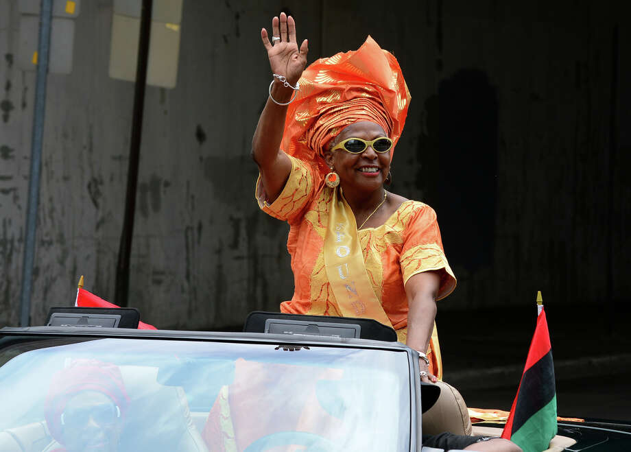 Cynthia Griffin, Founder of the Annual Juneteenth African-American Caribbean Freedom Day Parade rides along in the parade route in downtown Bridgeport, Conn. on Saturday June 14, 2014. Photo: Christian Abraham / Connecticut Post