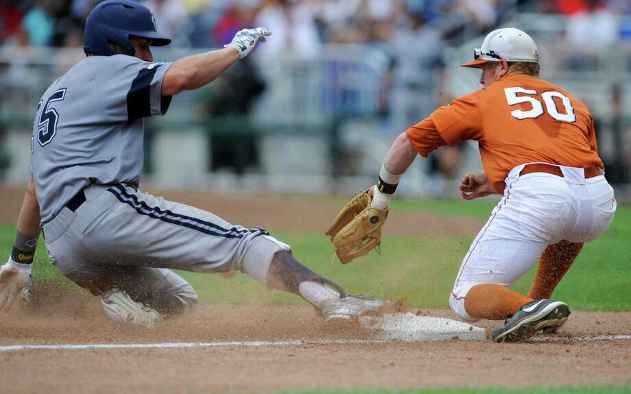 UC Irvine third baseman Taylor Sparks (25) is safe at third base against Texas third baseman Zane Gurwitz (50), on his one-run triple in the eighth inning of an NCAA baseball College World Series game against Texas, in Omaha, Neb., Saturday, June 14, 2014. UC Irvine won 3-1. (AP Photo/Dave Weaver) Photo: Dave Weaver, Associated Press / FR67562 AP
