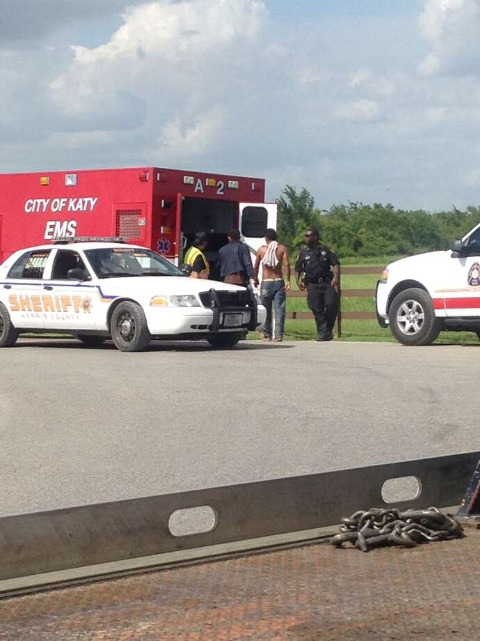Harris County deputies and other law enforcement officials comb through a field in Katy after a stolen pickup truck carrying more than a dozen people crashed and its occupants fled around 12 p.m. Saturday. (Photo courtesy of Mason Boswell)